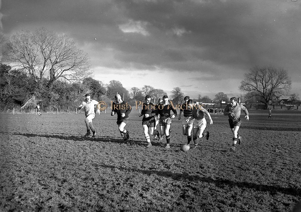 Irish Rugby Football Union, Ireland v Scotland, Five Nations, Irish team practice at Clonskeagh, Dublin, Ireland, Thursday 28th March, 1958,.28.3.1958, 3.28.1958,..Irish Team, ..P J Berkery, Wearing number 15 Irish jersey, Full back, Landsdowne Rugby Football Club, Dublin, Ireland, and, London Irish Rugby Football Club, Surrey, England, ..A J O'Reilly, Wearing number 14 Irish jersey, Right Wing, Old Belvedere Rugby Football Club, Dublin, Ireland,  ..N J Henderson, Wearing number 13 Irish jersey, Right centre, N.I.F.C, Rugby Football Club, Belfast, Northern Ireland, ..D Hewitt, Wearing number 12 Irish jersey, Left centre, Queens University Rugby Football Club, Belfast, Northern Ireland,..A C Pedlow, Wearing number 11 Irish jersey, Left wing,  C I Y M S Rugby Football Club, Belfast, Northern Ireland, ..J W Kyle, Wearing number 10 Irish jersey, Stand Off, N.I.F.C, Rugby Football Club, Belfast, Northern Ireland, ..A A Mulligan, Wearing number 9 Irish jersey, Scrum Half, Cambridge University Rugby Football Club, Cambridge, England, and, Wanderers Rugby Football Club, Dublin, Ireland, ..P J O'Donoghue, Wearing  Number 1 Irish jersey, Forward, Bective Rangers Rugby Football Club, Dublin, Ireland,  ..A R Dawson, Wearing number 2 Irish jersey, Forward, Wanderers Rugby Football Club, Dublin, Ireland, ..B G M Wood, Wearing number 3 Irish jersey, Forward, Garryowen Rugby Football Club, Limerick, Ireland, ..J B Stevenson, Wearing number 4 Irish jersey, Forward, Instonians Rugby Football Club, Belfast, Northern Ireland,..W A Mulcahy, Wearing number 5 Irish jersey, Forward, University College Dublin Rugby Football Club, Dublin, Ireland, ..J A Donaldson, Wearing number 6 Irish jersey, Forward, Collegians Rugby Football Club, Belfast, Northern Ireland, ..J R Kavanagh, Wearing number 7 Irish jersey, Forward, Wanderers Rugby Football Club, Dublin, Ireland, ..N A Murphy, Wearing number 8 Irish jersey, Forward, Cork Constitution Rugby Football Club, Cork, Ireland,.