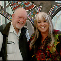 """Melanie and Charles Everest.-. To celebrate the 40th anniversary of the original Great Festival Melanie was invited back to the IOW. She performed a wonderful set, and Charles was delighted to present Melanie and John Giddings each with a copy of his original 1970 print.  .This photograph was taken in the media tent in front of Guy Portelli's """"Hey Joe"""" sculpture.By kind permission of John Giddings, promoter and organiser of the 2010 Isle of Wight festival."""