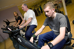 People using upright fitness bike at Southglade Leisure Centre; Nottingham
