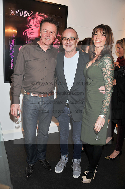 Left to right, PAUL YOUNG, BRUNO BISANG and STACEY YOUNG at a Private View of Bruno Bisang 30 Years of Polaroids held at The Little Black Gallery, 13A Park Walk, London SW10 on 15th January 2013.