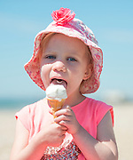 ***parental permission given for use***© Licensed to London News Pictures. 03/07/2014. Bognor Regis, UK. Hannah Colley aged 4 enjoys an ice crem on the seafront.  People enjoy the hot sunny weather at the seaside resort of Bognor Regis today 3rd July 2014. Forecasters are predicting it to be the hottest day of 2014 so far. Photo credit : Stephen Simpson/LNP