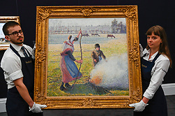 © Licensed to London News Pictures. 29/01/2020. LONDON, UK. Technicians present ''Gelée Blanche, Jeune Paysanne Faisant Du Feu'' by Camille Pissarro, (Est. £8,000,000 - 12,000,000). Preview of Sotheby's Impressionist & Modern and Surrealist Art sales.  The auction will take place at Sotheby's New Bond Street on 4 and 5 February 2020.  Photo credit: Stephen Chung/LNP