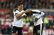 Aleksandar Dragoic of Austria (l) checks the head of Kevin Danso of Austria ® after he had taken a knock. Wales v Austria , FIFA World Cup qualifier , European group D match at the Cardiff city Stadium in Cardiff , South Wales on Saturday 2nd September 2017. pic by Andrew Orchard, Andrew Orchard sports photography