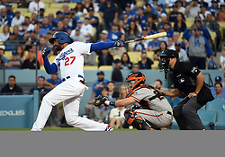 March 29, 2018 - Los Angeles, CA, U.S. - LOS ANGELES, CA - MARCH 29: Los Angeles Dodgers Outfield Matt Kemp (27) follows through after connecting for a single in the 9th inning during the MLB opening day game between the San Francisco Giants and the Los Angeles Dodgers on March 29, 2018 at Dodger Stadium in Los Angeles, CA. (Photo by Chris Williams/Icon Sportswire) (Credit Image: © Chris Williams/Icon SMI via ZUMA Press)