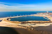 Nederland, Rotterdam, Maasvlakte, 20-03-2009; De Slufter, grootschalige opslagplaats voor vervuild havenslib. De verontreinigde baggerspecie komt voort uit het onderhoudsbaggerwerk in de Rotterdamse haven waarbij de haven op diepte wordt gehouden. Langs de rand van de Slufter zijn windmolens gebouwd en in de Noordzee, direkt links naast het depot, wordt de Tweede Maasvlakte aangelegd. Links aan de horizon de poederkoolgestookte elektricitieitscentrale van E.ON (EON), in het midden aan de verre horizon de kust van Delfland. Slufterstrand (Strand Slufter) in de voorgrond.<br /> The Slufter, large-scale storage for contaminated harbor sludge.<br /> luchtfoto (toeslag op standard tarieven);<br /> aerial photo (additional fee required);<br /> copyright foto/photo Siebe Swart