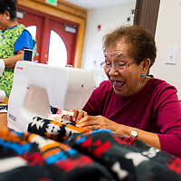 112013       Brian Leddy<br /> Etta Norris laughs while sewing a jacket at the Twin Lakes Senior Center Wednesday. The center recently purchased new sewing machines and have been sewing coats for themselves as well as to give away to those in need.