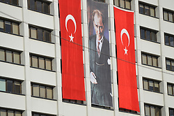 August 29, 2017 - Ankara, Turkey - Two Turkish flags and a portrait of Mustafa Kemal Ataturk (C), founder and the first president of modern Turkey, can be seen posted on a building in the historic Ulus district of Ankara, Turkey on August 29, 2017 as Turkish citizens prepare to celebrate the 95th anniversary of the Victory Day on August 30. (Credit Image: © Altan Gocher/NurPhoto via ZUMA Press)
