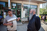 A group of men talking in front of the local grocery store in the city of Crnik. Crnik has almost 90% of unemployment.