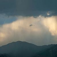 Rain squalls drift over the Bridger Mountains near Bozeman, Montana.
