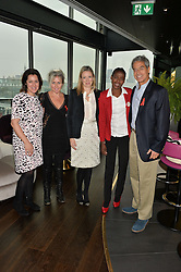 Left to right, mothers2mothers European Director Emma France EMMA FRANCE, AMANDA BRETHERTON President of Next Model Management, STEPHANIE PHAIR president of the OUTNET.COM, JOHANNA SATEKGE and DR MITCH BESSER at the mothers2mothers World AIDS Day VIP Lunch with Next Management & THE OUTNET.COM held at Mondrian London, 19 Upper Ground, London on 1st December 2014.