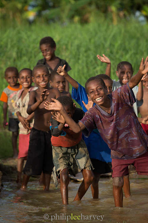 Children waving, Togum Village, Lake Murray, Middle Fly District, Western Province, Papua New Guinea