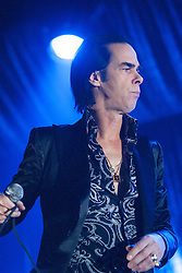 Open shirted frontman Nick Cave, of Nick Cave and the Bad Seeds, on stage tonight at The Barrowlands, Glasgow, Scotland.<br /> ©Michael Schofield.