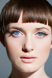 Young Woman with Blue Eyes and Black Eyeliner, Close-up view