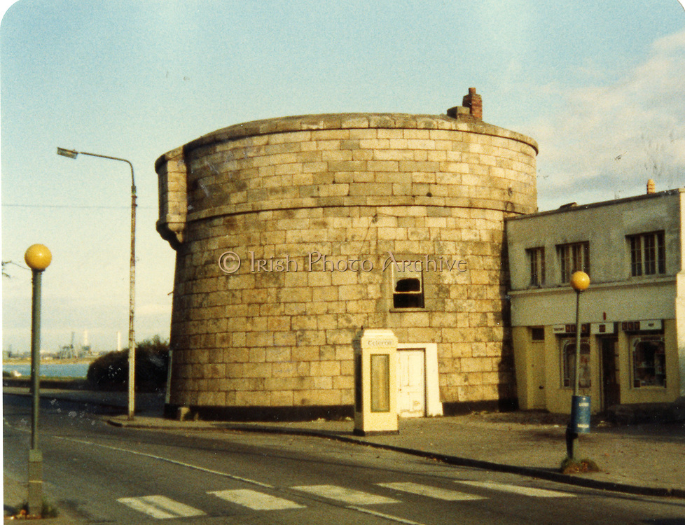 Old amateur photos of Dublin streets churches, cars, lanes, roads, shops schools, hospitals, Streetscape views are hard to come by while the quality is not always the best in this collection they do capture Dublin streets not often available and have seen a lot of change since photos were taken November 1984, Sandymount Martello Tower, strand, swimming, baths, Gordon Hill, Royal Hospital from Train Station,