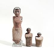 Three Egyptian wooden figurines 1st millennium BCE