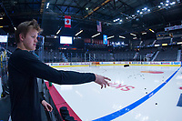 REGINA, SK - MAY 18: Arthur Kaliyev #34 of Hamilton Bulldogs throws pucks on to the ice for warm up against the Regina Pats at the Brandt Centre on May 18, 2018 in Regina, Canada. (Photo by Marissa Baecker/Shoot the Breeze)