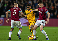 Football - 2018 / 2019 Premier League - West Ham United vs. Brighton & Hove Albion<br /> <br /> Declan Rice (West Ham United) and Jurgen Locadia (Brighton & Hove Albion) <br /> at the London Stadium<br /> <br /> COLORSPORT/DANIEL BEARHAM