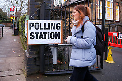 © Licensed to London News Pictures. 12/12/2019. London, UK. A voter leaves a polling station in Haringey, north London after voting in the UK General Election. Polling stations have opened as the nation votes to decide the next UK Government in the first December election since 1923. Photo credit: Dinendra Haria/LNP