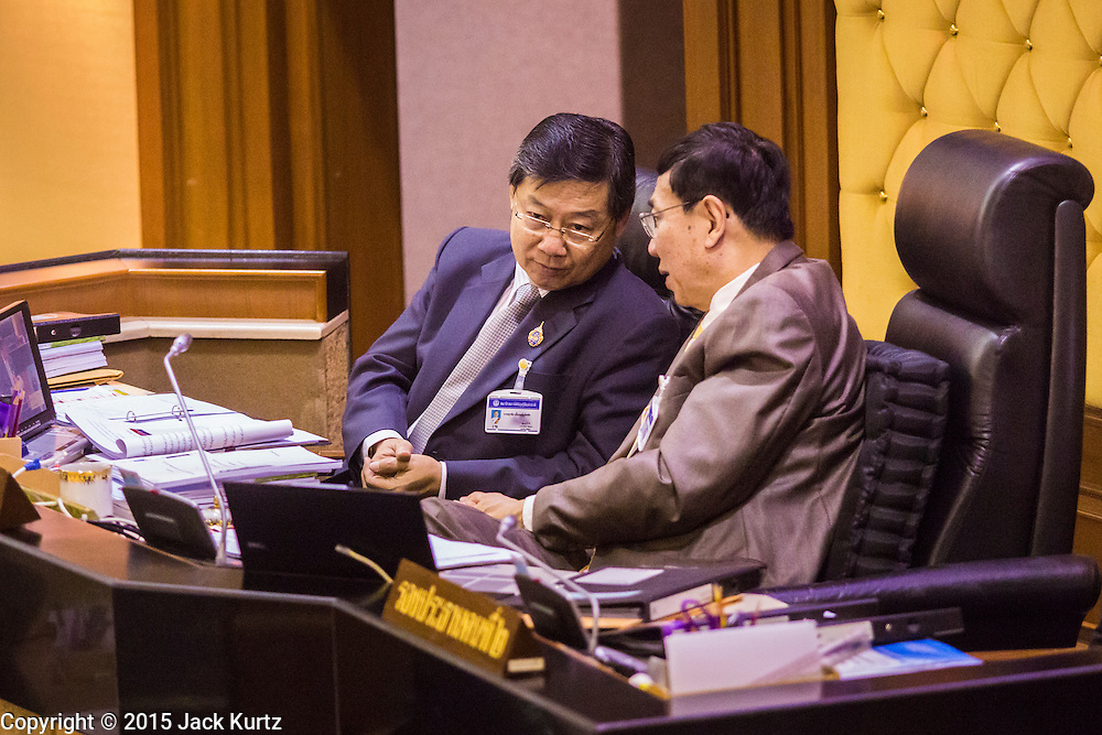 """09 JANUARY 2105 - BANGKOK, THAILAND: PORNPETCH WICHITCHOLCHAI, (RIGHT) President of the Thai National Legislative Assembly (NLA) during the impeachment trial of former Prime Minister Yingluck Shinawatra. Thailand's military-appointed National Legislative Assembly began impeachment hearings Friday against former Prime Minister Yingluck Shinawatra. If she is convicted, she could be forced to stay out of politics for five years. During her defense, Yingluck questioned the necessity of her impeachment, saying, """"I was removed from office, the equivalent of being impeached, three times already, I have no position left to be impeached from."""" A decision on her impeachment is expected by the end of January.    PHOTO BY JACK KURTZ"""