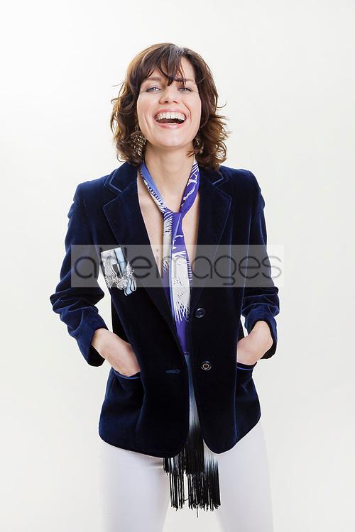 Woman Wearing Velvet Jacket Smiling