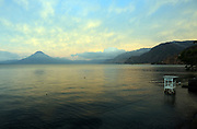 Early morning view across Lake Atitlan from Panajachel towards the towns of San Pedro and San Juan. To the left is Volcan San Pedro 3020m.. Panajachel, Republic of Guatemala. 04Mar14.