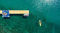 Aerial view of people kayaking near pier at the ocean, Mali Lošinj, Croatia.