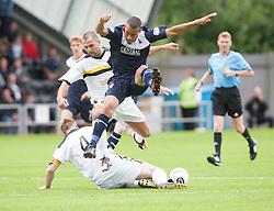 Falkirk's Phil Roberts over Dumbarton's Andy Graham.<br /> half time : Dumbarton 0 v 0 Falkirk, Scottish Championship 10/8/2013.<br /> ©Michael Schofield.