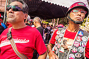 08 MAY 2013 - BANGKOK, THAILAND: Red Shirts listen to speakers at a protest at the Constitutional Court in Bangkok. A splinter group of the Red Shirts, Thai supporters of exiled Prime Minister Thaksin Shinawatra, have besieged the Thai Constitutional Court for the last three weeks calling for the resignation of the justices, who have indicated they might oppose a proposed constitutional reform which would grant amnesty to people convicted of political crimes since 2007. This would probably include Thaksin. The justices have refused to step down. Wednesday the protesters moved their protest to the Thai Parliament, which is largely powerless to intervene.   PHOTO BY JACK KURTZ