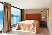 Interior, beautiful modern penthouse, bedroom