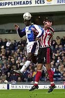 Photo. Glyn Thomas<br />Blackburn Rovers v Southampton. FA Barclaycard Premiership.<br />Ewood Park, Blackburn. 08-02-2003.<br />Blackburn's Andrew Cole (L) leaps above Claus Lundekvam