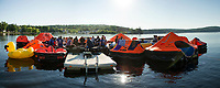 """The overnight crew awakes to a calm Saturday morning on Meredith Bay during the Make A Wish """"Rafting for Wishes"""" event at Hesky Park on Saturday.  (Karen Bobotas/for the Laconia Daily Sun)"""