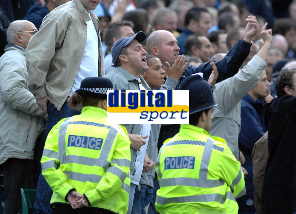Photo: Ashley Pickering.<br /> Gillingham v Leeds United. Coca Cola League 1. 29/09/2007.<br /> Police keep a close eye on Leeds fans as seats are thrown after the sending offs
