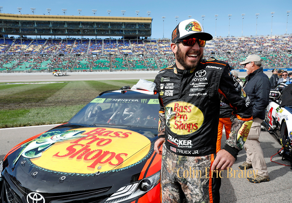 Points leader Martin Truex Jr. reacts as he waits by his car before the start of a NASCAR Cup Series auto race at Kansas Speedway in Kansas City, Kan., Sunday, Oct. 22, 2017. (AP Photo/Colin E. Braley)