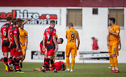 Annan Athletic's Ross Ferguson injured in a tackle by Livingston Ricki Lamie (3), who is sent off. Livingston 1 v 0 Annan Athletic, Scottish League Cup Group F, played 21/7/2018 at Prestonfield, Linlithgow.
