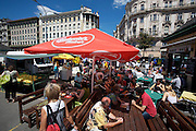 The Naschmarkt, Vienna's biggest market. Art Deco houses by famous architect Otto Wagner. Open air restaurant with umbrellas sponsored by Czech Budweiser beer.