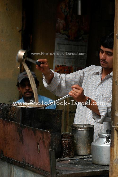 India, Manali, Kullu District, Himachal Pradesh, Northern India, a man at a chai shop preparing chai