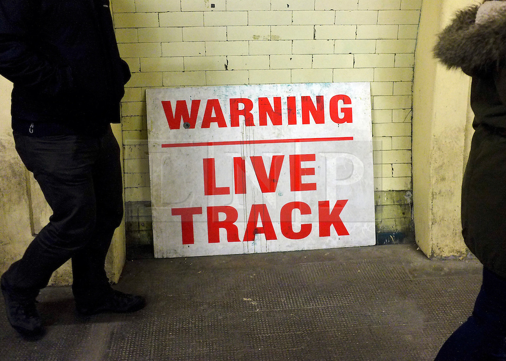 """© Licensed to London News Pictures. 02/12/2012. London, UK A sign saying 'Warning - Live Track"""" leans against a wall. London Transport Museum held tours, today 2nd December 2012, of Aldwych Tube Station, one of London's closed underground stations. Visitors were give a rare chance to glimpse what happens to a station after the public leave. The tour included a platform closed in 1914 which was used as a store for the National Gallery during the 2nd World War, amongst items stored were the Elgin Marbles. The station was used by 1000's of Londoners during the blitz as an air raid shelter. The station is often used for filming with films such as Atonement, V for Vendetta, Superman 4 and 28 weeks later. Photo credit : Stephen Simpson/LNP"""