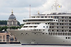 © Licensed to London News Pictures. 03/07/2016. One of the domes of the Old Royal Naval College at Greenwich comes in to view at The World arrives at Greenwich. The World residential cruise ship has arrived in Greenwich, London. MS The World is a residence at sea, carrying wealthy passengers around the world who own apartments on board. The ship, which was launched in 2002, has 165 apartments.  As well as six restaurants, the World has a large lobby, gourmet deli and grocery store, a boutique and showroom, fitness center, billiard room, golf simulator and putting greens, a full-sized tennis court, jogging track, a spa, swimming pool, and cocktail lounge. The World last visited London in 2013. Credit: Rob Powell/LNP