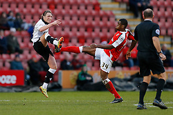 Luke Ayling of Bristol City is caught in the leg by the boot of Uche Ikpeazu of Crewe Alexandra as referee A. Haines looks on - Photo mandatory by-line: Rogan Thomson/JMP - 07966 386802 - 20/12/2014 - SPORT - FOOTBALL - Crewe, England - Alexandra Stadium - Crewe Alexandra v Bristol City - Sky Bet League 1.