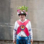 Portrait of a member of Ripon City Morris Dancers at the 31st York Festival of Traditional Dance on 8th September 2018. Ripon City Morris Dancers are a North West Morris dancing team from Ripon in North Yorkshire instantly recognisable by their patriotic costume and fresh flowered hats