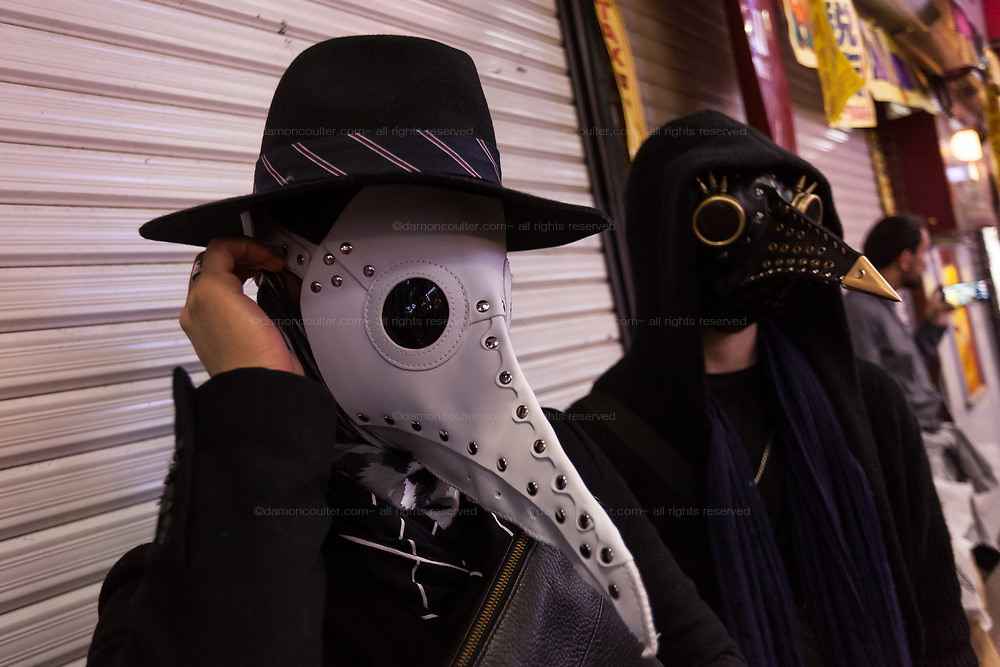 Two man in Plague-doctor, beaked masks during the Halloween celebrations Shibuya, Tokyo, Japan. Saturday October 27th 2018. The celebrations marking this event have grown in popularity in Japan recently. Enjoyed mostly by young adults who like to dress up, drink , dance and misbehave in parts of Tokyo like Shibuya and Roppongi. There has been a push back from Japanese society and the police to try to limit the bad behaviour.