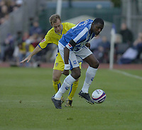Photo: Matt Bright.<br /> Brighton and Hove Albion v Leeds United. Coca Cola League 1. 20/10/2007.<br /> Jamie Clapham of Leeds Utd and Bas Savage of Brighton challenge for the ball