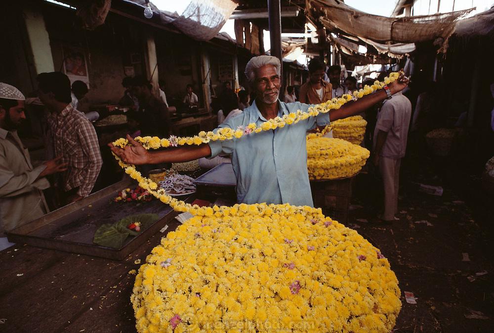Flower vendor in public market in Mysore, South India.