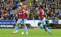 West Ham United's Felipe Anderson (left) celebrates scoring his side's first goal of the game during the Premier League match at the John Smith's Stadium, Huddersfield.