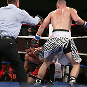 "Steed Woodall (white shorts) and Daniel Rodriguez fight during the ""Boxeo Telemundo"" boxing match at the Kissimmee Civic Center on Friday, March 14, 2014 in Kissimmme, Florida. (Photo/Alex Menendez)"