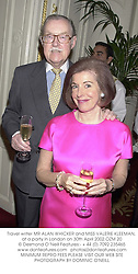 Travel writer MR ALAN WHICKER and MISS VALERIE KLEEMAN, at a party in London on 30th April 2002.OZM 20