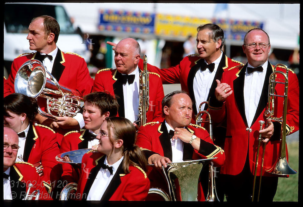 Concert band members pose for photo after performing at the annual National Eisteddfod cultural festival; Meifod, Wales.