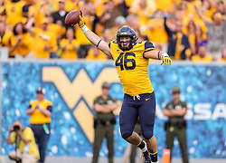 Sep 22, 2018; Morgantown, WV, USA; West Virginia Mountaineers defensive lineman Reese Donahue (46) celebrates after recovering a fumble recovery during the third quarter against the Kansas State Wildcats at Mountaineer Field at Milan Puskar Stadium. Mandatory Credit: Ben Queen-USA TODAY Sports