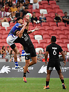 Samoa's John Vaili competes for a high ball with New Zealand's Dylan Collier during the HSBC Singapore Rugby Sevens 5th Place Play-off - Samoa v New Zealand won by Samoa 19-17 at The National Stadium, Singapore, Sunday, April 14th, 2019. (Steve Flynn/Image of Sport)