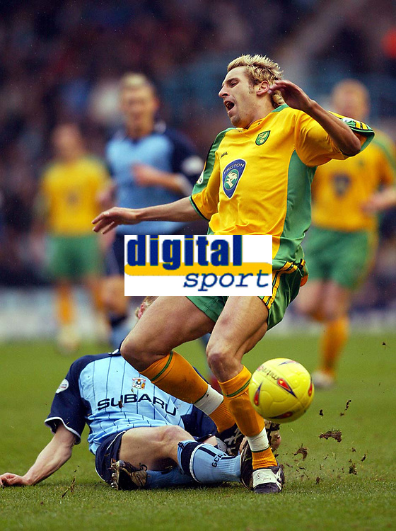 Photo: Scott Heavey.<br />Coventry v Norwich. Nationwide Division One. 14/02/2004.<br />Darren Huckerby is fouled by Calum Davenport